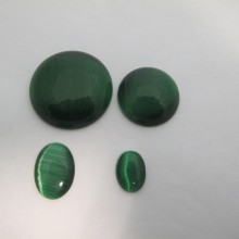 Green glass cat's eye cabochons