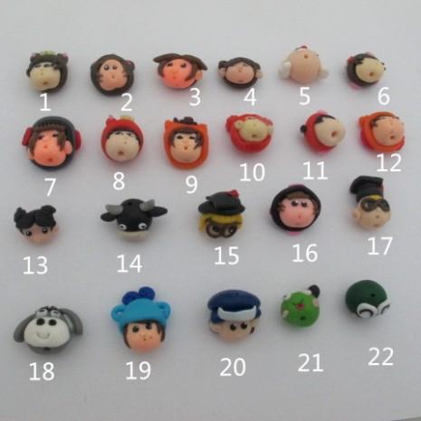 10 perles tête de poupée en pate a modeler a cuire